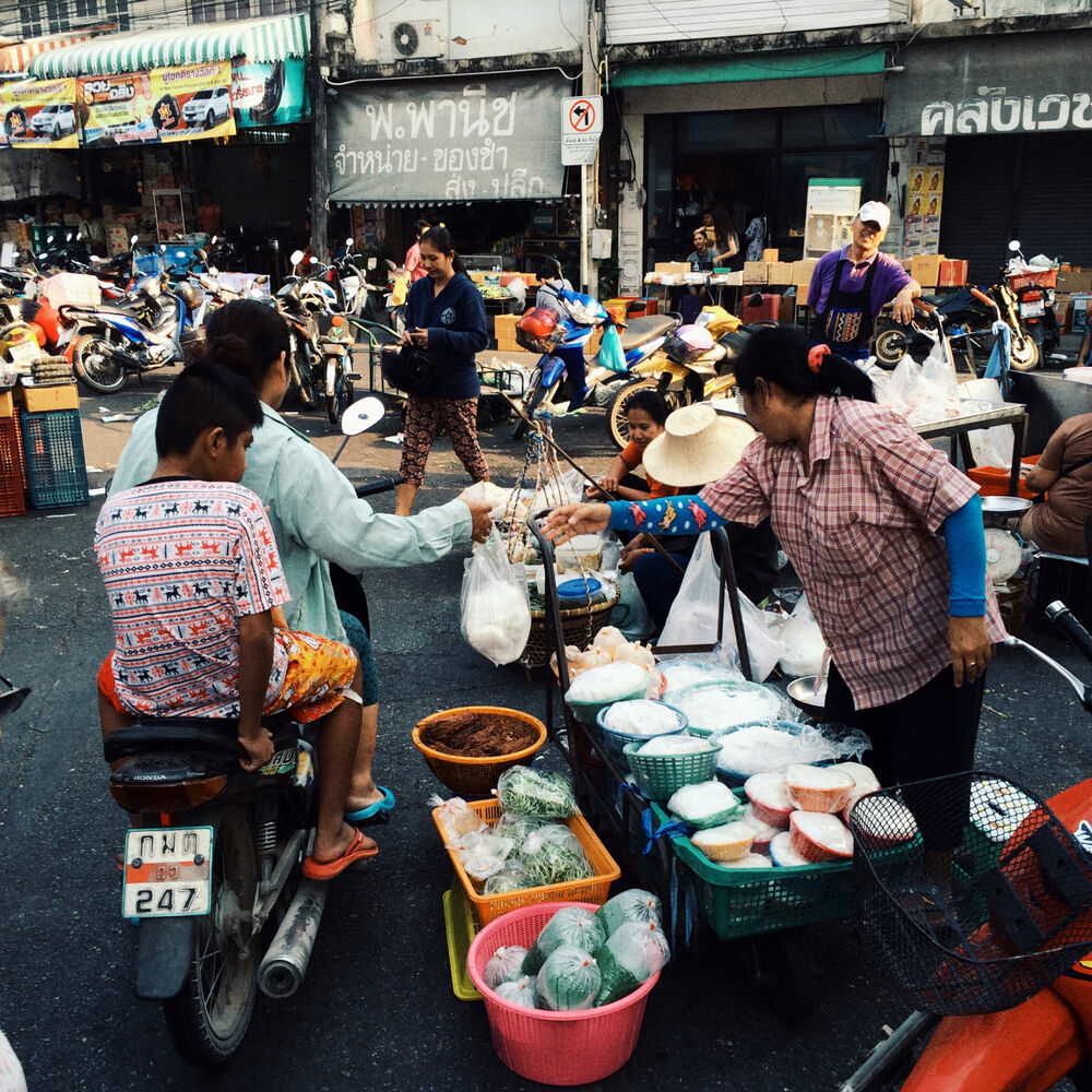 A bustling street market in Kanchanaburi is an easy place to buy bananas and other treats. (Colin Corneau/Brandon Sun)