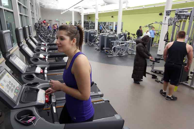 Sara Matwychuk works out on a treadmill in Brandon University's new Healthy Living Centre on Monday evening. The new gym has 4,100 square feet of space and is soon open for public use.