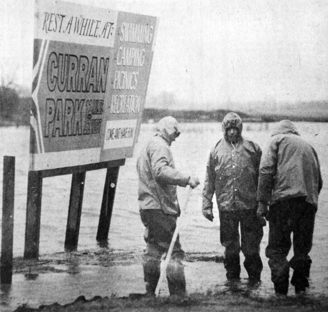 Rest a while at Curran Park, says the sign. There was little rest on the weekend for work crews fighting to protect Brandon from the waters of the Assiniboine River. And while the billboard boasted of the swimming facilities at Curran Park, recreation was no doubt far from the minds of the wet and weary workmen in the photograph. (Brandon Sun archives, April 17, 1976)