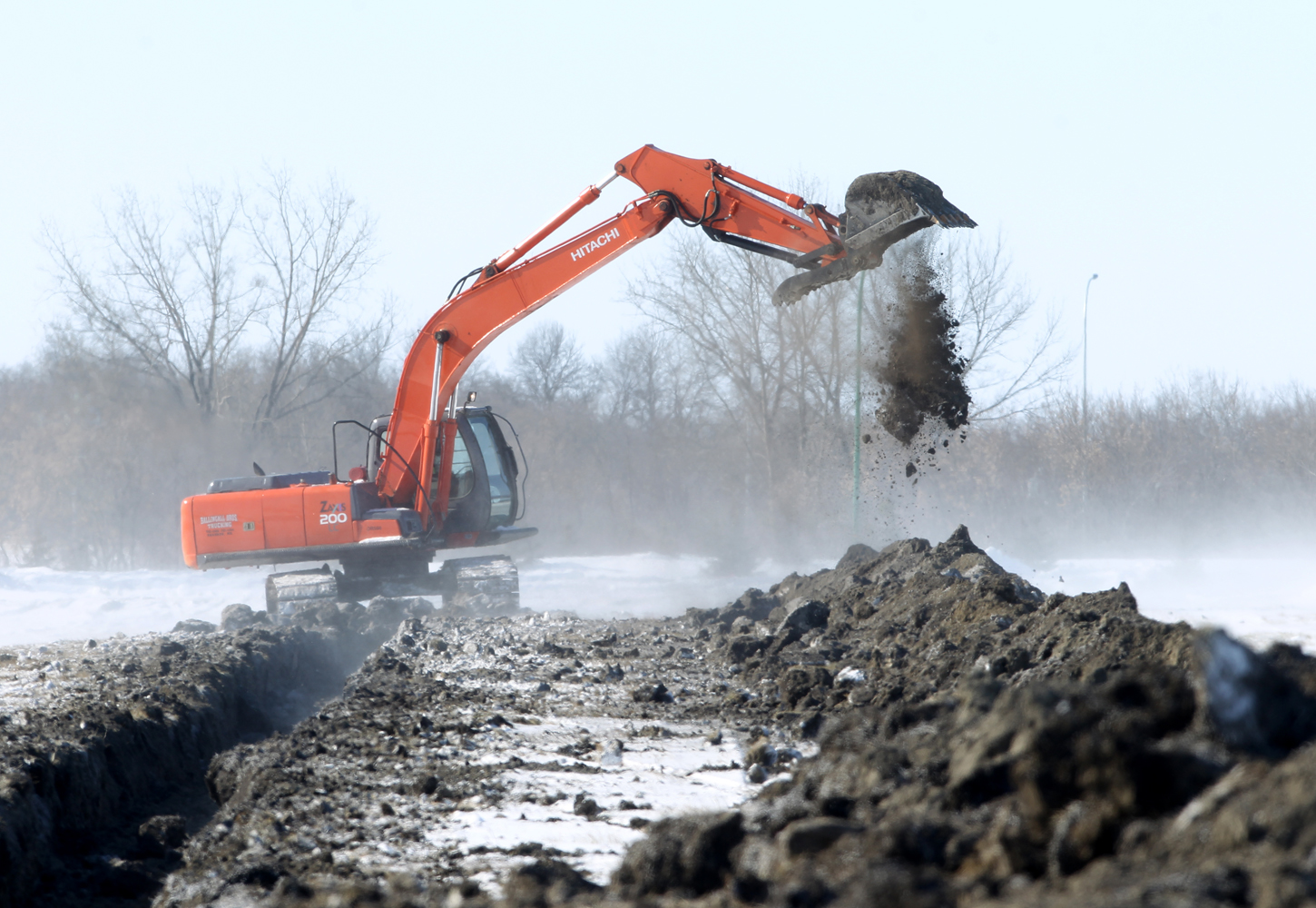Work on the dike on the north side of the Assiniboine River at the Riverbank Discovery Centre was being done on March 1. (Tim Smith/Brandon Sun)