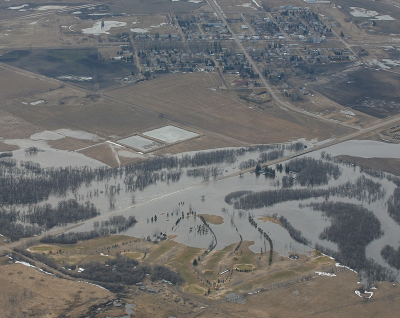 Flood waters from the Souris River flows over Highway 21 at the Hartney Golf Course on April 21, 2011.