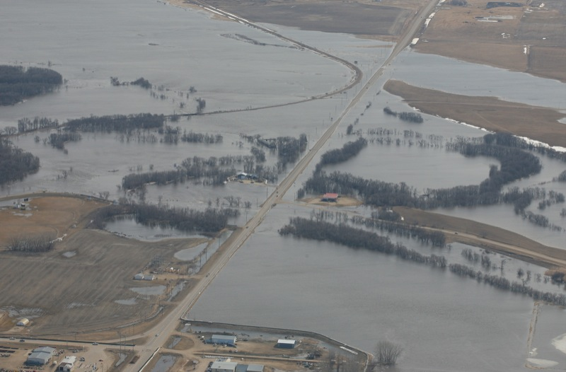 Water flows under the bridge on Highway 3 to the east of the town of Melita, Man., on April 21, 2011.