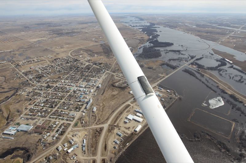 The Souris River spills over the valley floor south of the town of Melita, Man., on Apr. 21, 2011.