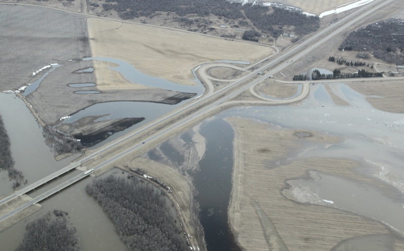 The Assiniboine River flows under the Trans-Canada Highway at the Grand Valley Road exit on Apr. 21, 2011.