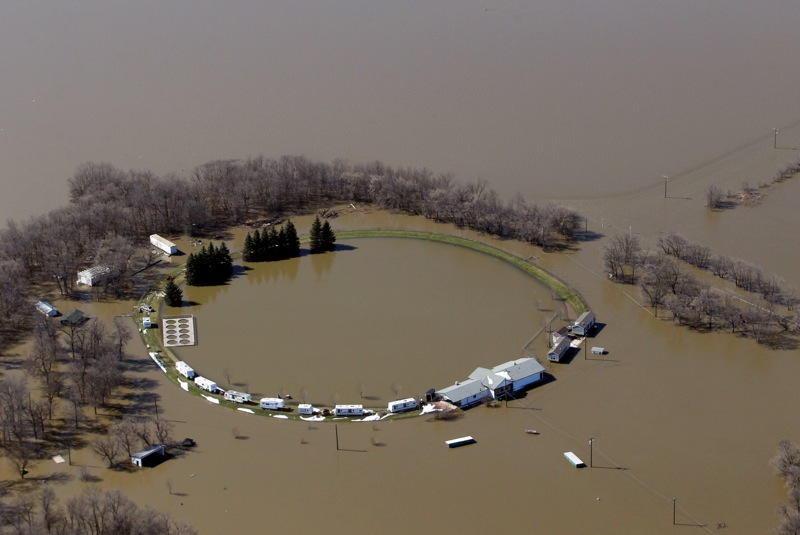 Campers sit parked on what little dry land remains at Turtle Crossing campground as flood waters from the swollen Assiniboine River envelop the rest of the campground on Monday. (Tim Smith/Brandon Sun)