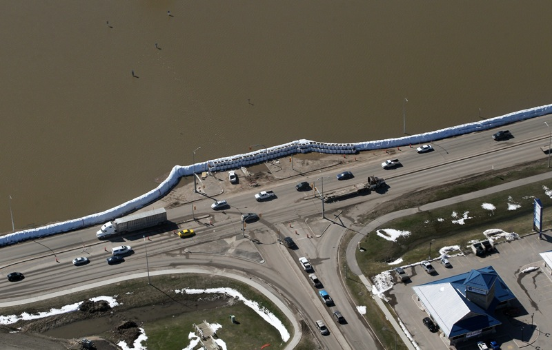 The dike at 18th Street and Grand Valley Road is seen from the air on Monday after a second line of super sandbags was built to reinforce the dike.