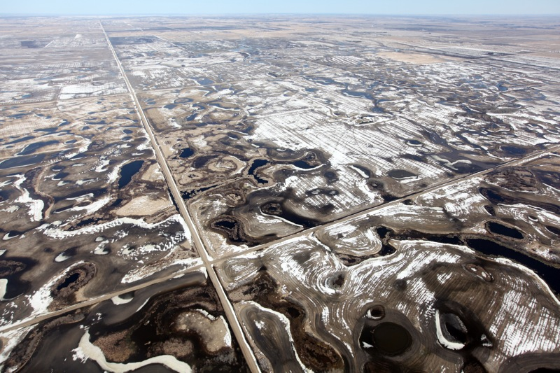 Pockets of water dot the landscape north of Souris on Monday. (Tim Smith/Brandon Sun)