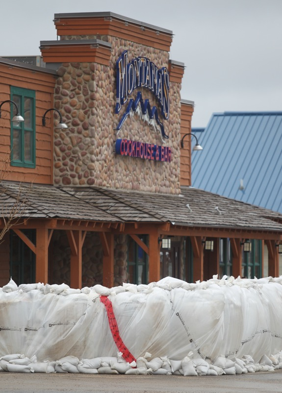 A wall of super sandbags for a barrier ahead Montana's Cookhouse in the Corral Centre on Tuesday in preparation of breach in the main dike along 18th Street North. (Bruce Bumstead/Brandon Sun)