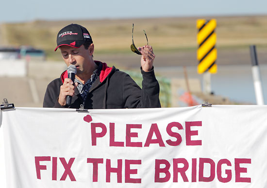 Kevin Gardiner of Waskada speaks during the rally. Gardiner's son was involved in a vehicle accident with a friend on the east side of the bridge and the responding ambulance was not able to cross the bridge, forcing it to take a lengthy detour.