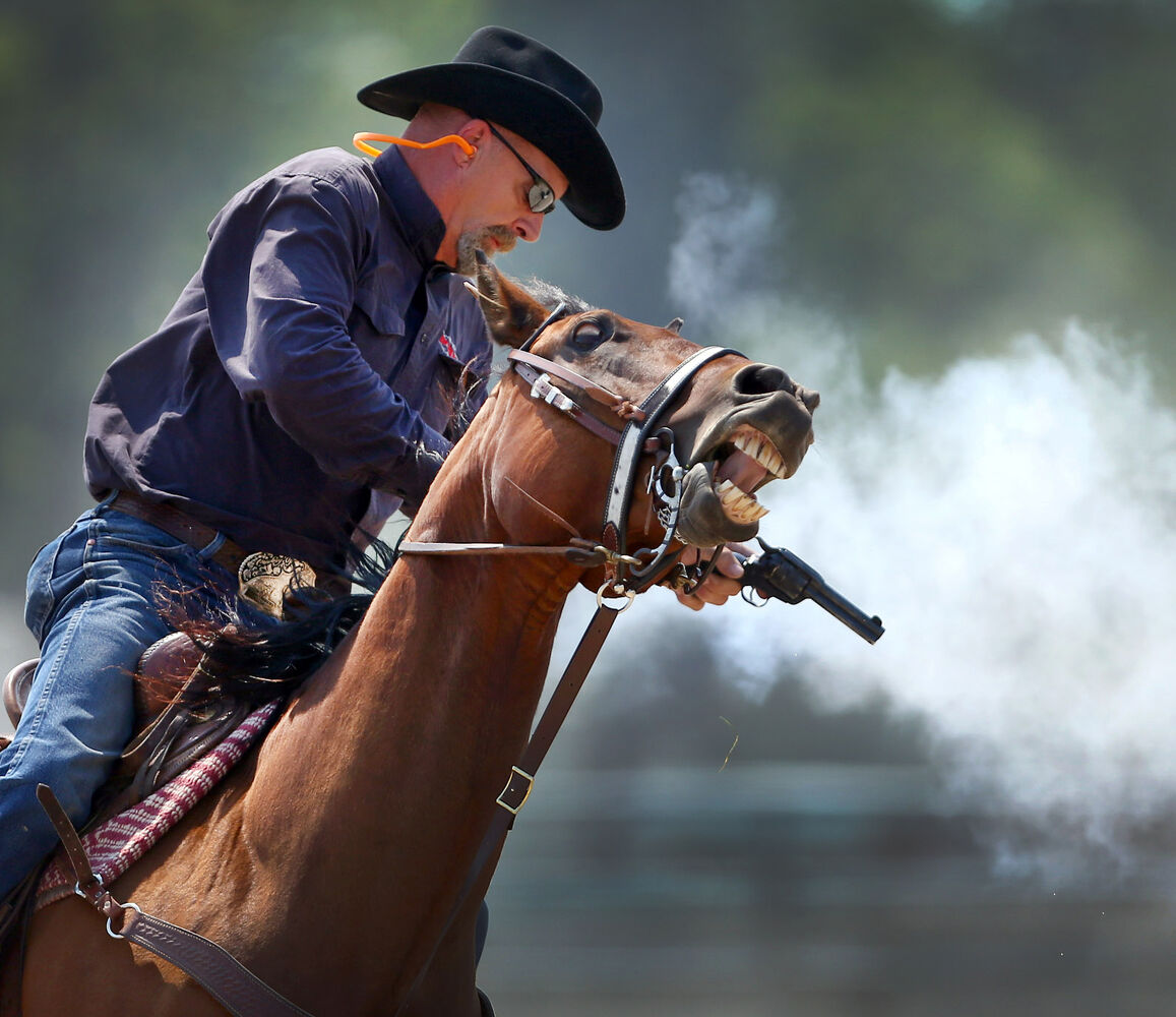 Robert Ball of Tyndall fires a black power cartridge from his six-shooter during the Manitoba Mounted Shooting Association's practice and competition held at the Keystone Centre in June. (Bruce Bumstead/Brandon Sun)