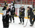 Kale Clague (left) is all smiles after scoring a goal at the end of the Wheat Kings' team practice Thursday.