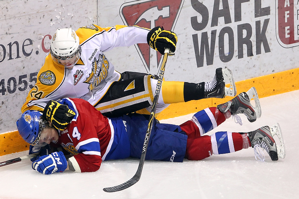Jens Meilleur #24 of the Brandon Wheat Kings comes down on top of Keegan Lowe #4 of the Edmonton Oil Kings during the Wheaties 6-0 game four loss to the Oil Kings.  (Tim Smith)