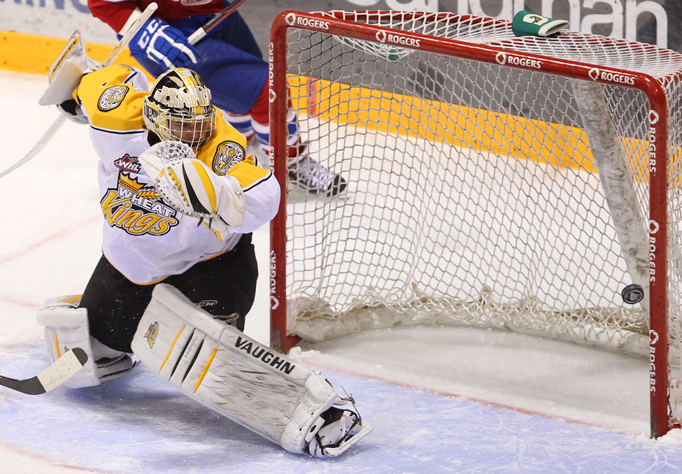 Goalie Corbin Boes #1 of the Brandon Wheat Kings looks back as the puck sails into the net for an Edmonton Oil Kings goal during game four.