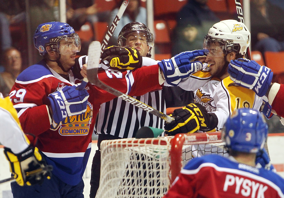 Darian Dziurzynski #19 of the Brandon Wheat Kings and Mitchell Moroz #29 of the Edmonton Oil Kings exchange jabs during the third period of game three. (Tim Smith/Brandon Sun)