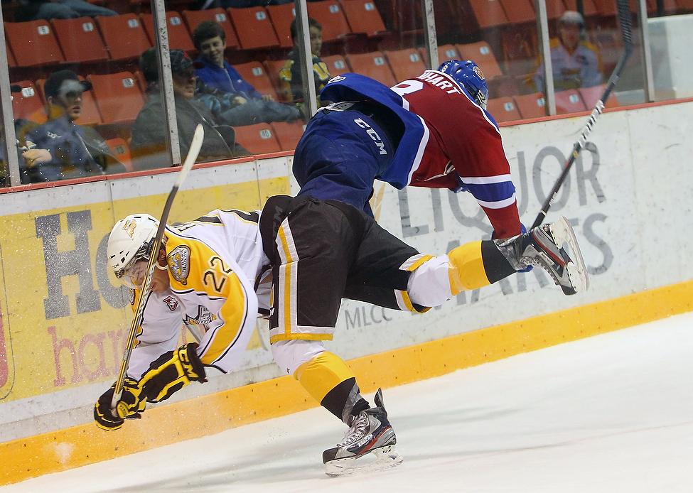 Dominick Favreau #22 of the Brandon Wheat Kings collides with Griffin Reinhart #8 of the Edmonton Oil Kings during the third period of game three of their WHL playoff series.