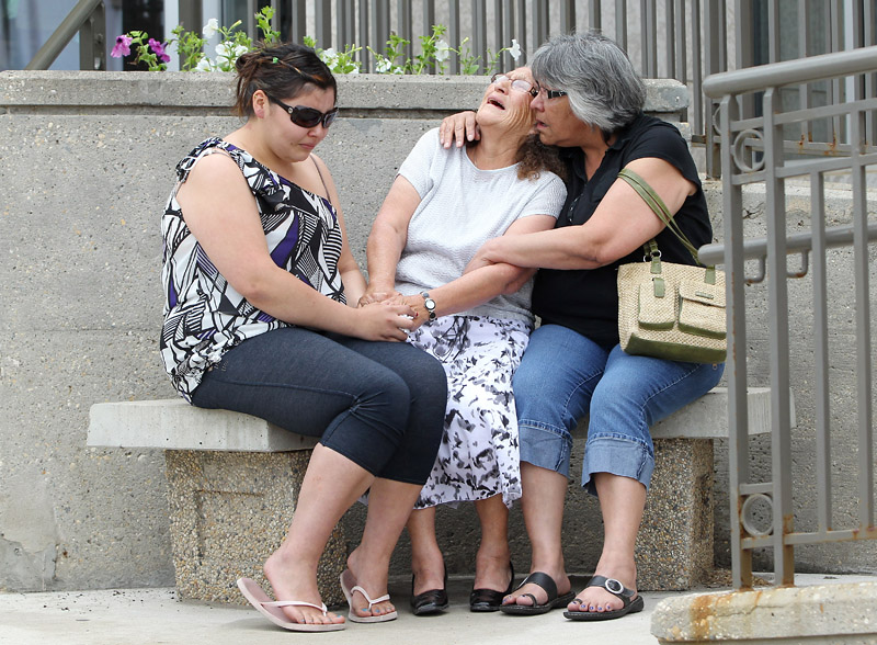 Anne Lacquette, the grandmother of Duane Lacquette, is comforted as she sobs outside the Brandon courthouse on Thursday after Jason John Ouimet was sentenced in the manslaughter death of her grandson. Ouimet was sentenced to five years in prison.