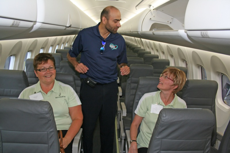 Brandon economic development officer Sandy Trudel (left) and Brandon Mayor Shari Decter Hirst (right) speak with a Bombardier representative while in Calgary last June to pitch the city to WestJet.