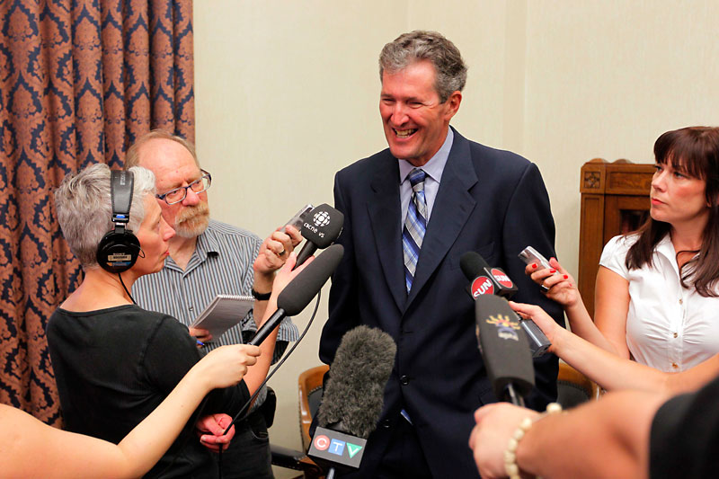 New Progressive Conservative Leader Brian Pallister speaks with reporters on Monday in Winnipeg.