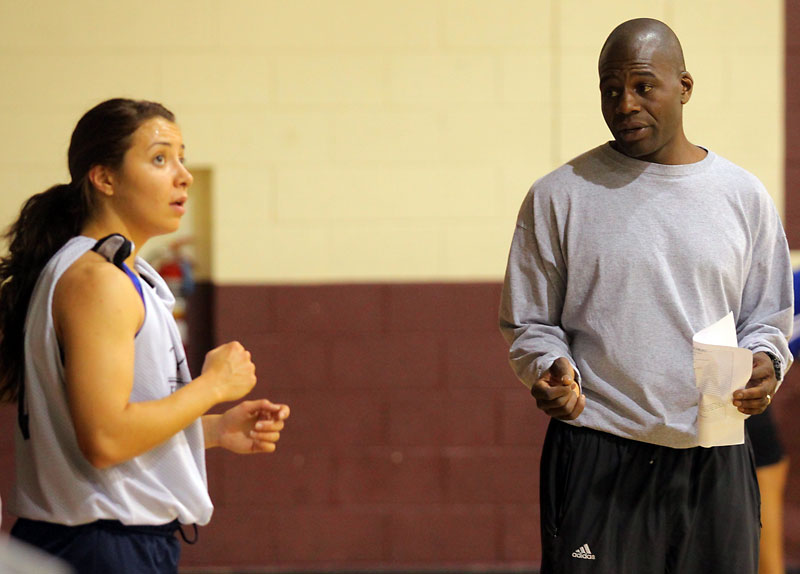 New Brandon University Bobcats women's basketball coach Novell Thomas works with his players during a practice at New Era School on Thursday.