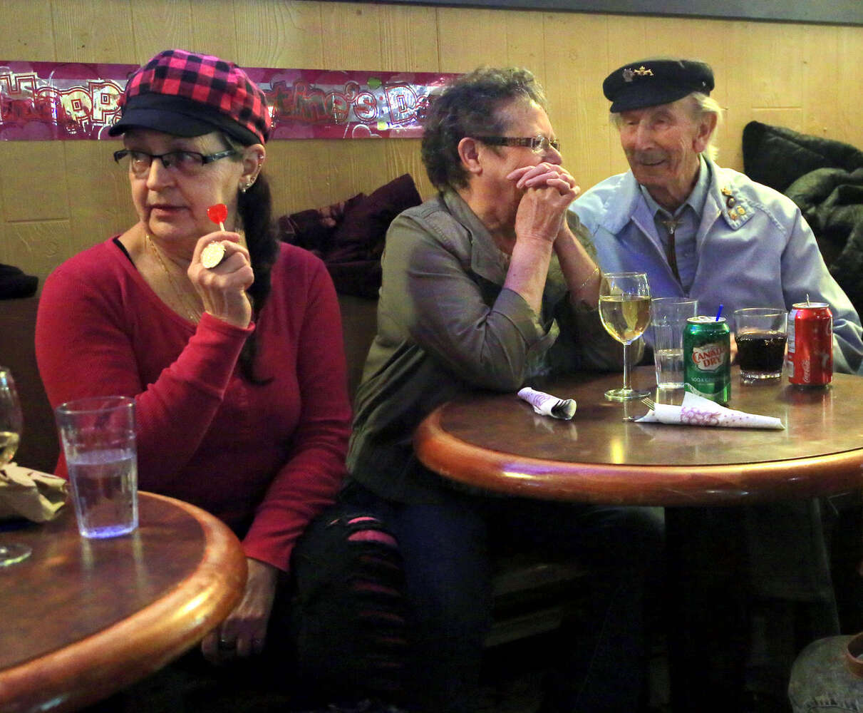 Patrons chat with friends old and new in the beverage room at the Crystal. (Colin Corneau)