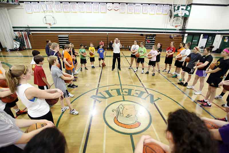 NBA shooting consultant Dave Love speaks to young basketball players during a basic shooting mechanics clinic for boys and girls in grades 7-12 at the Neelin High School gymnasium on Sunday morning.