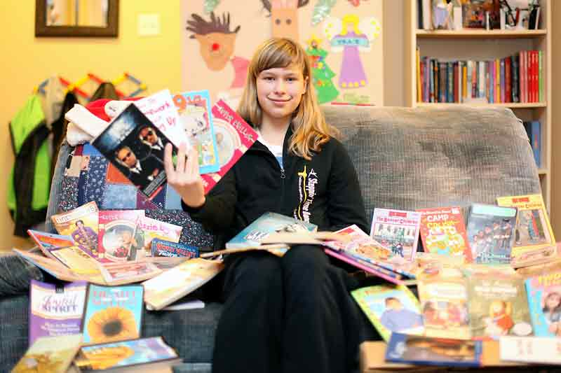 Riverview School Grade 6 student Katie Wilson, 11, began a book drive at her school to collect books to put in Christmas hampers that will be distributed by the Samaritan House in Brandon. The book drive has expanded beyond the school with Brandonites donating hundreds of books so far.