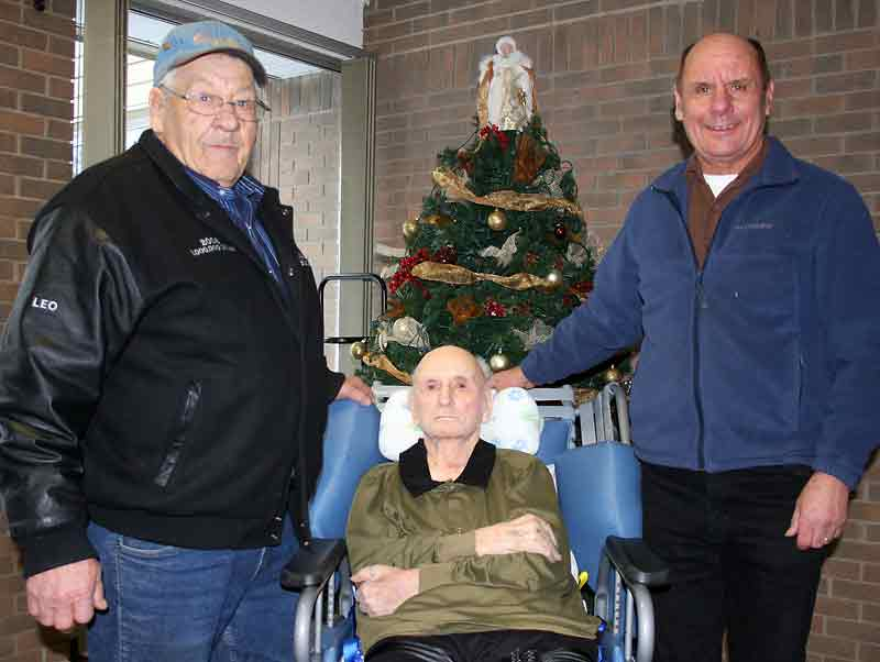 Leo Lafrance (left) was honoured at Quintaine's company Christmas party when the trucker, who has been with the company for 50 years, was given a new truck. Lafrance is pictured with Pete Quintaine (middle) and Jim Quintaine, who now runs the livestock brokerage and trucking business.