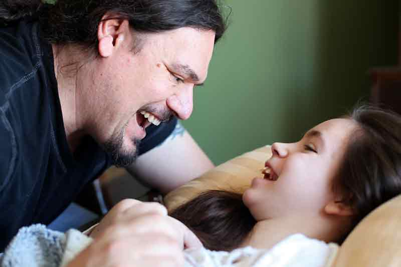 Trent Zazalak and his daughter, Tatyanna, smile at each other during a peaceful moment at home.
