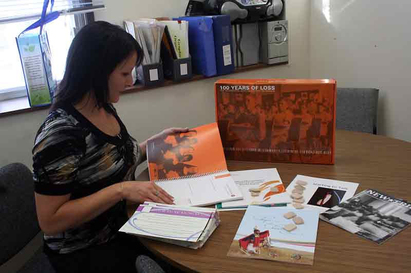 George Fitton School teacher Sherry Baker looks through learning materials from Project of Heart.