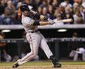 San Francisco Giants' Buster Posey singles against the Colordo Rockies to lead off in the sixth inning of a baseball game Saturday, April 25, 2015, in Denver. (AP Photo/David Zalubowski)
