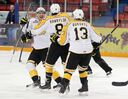 Eric Roy #7, Jayce Hawryluk #8 and Rihards Bukarts #13 of the Brandon Wheat Kings celebrate a goal by Hawryluk during the second period in game two of the first round of the WHL playoffs against the Edmonton Oil Kings at Westman Place on Friday evening.