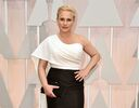 """FILE - In this Feb. 22, 2015 file photo, Patricia Arquette arrives at the Oscars at the Dolby Theatre in Los Angeles. Arquette has a deal with Random House for a memoir about her """"unconventional family,"""" single parenthood and life in Hollywood, the publisher announced Wednesday, April 1. The book is currently untitled and a release date has not been set. (Photo by Jordan Strauss/Invision/AP, File)"""