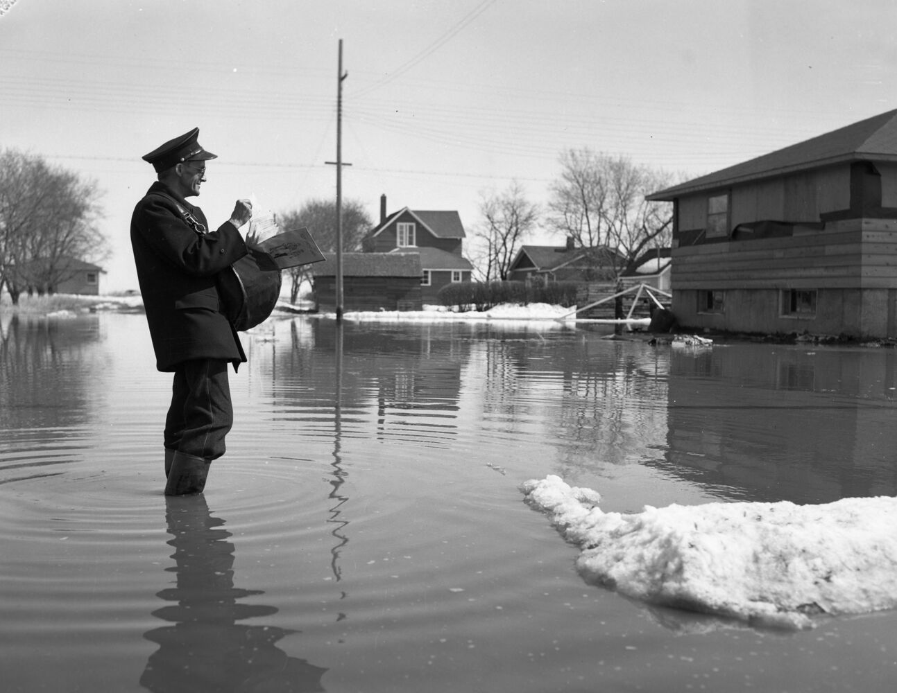 Neither snow, nor sleet, nor flood can stop the Brandon mail carriers in 1954. (Courtesy CKX fonds, S.J. McKee Archives, Brandon University)