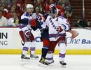 Washington Capitals left wing Alex Ovechkin (8), from Russia, gets tangled up with New York Rangers defenseman Dan Girardi (5) during the first period of Game 3 in the second round of the NHL Stanley Cup hockey playoffs, Monday, May 4, 2015, in Washington. (AP Photo/Alex Brandon)