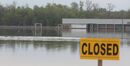 Ducks land on the water covering the playing fields at the Optimist soccer park last June.