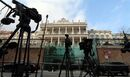 Cameras stand in front of Palais Coburg where closed-door nuclear talks of six world powers with Iran take place in Vienna, Austria, Sunday, Nov. 23, 2014. (AP Photo/Ronald Zak)