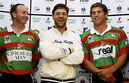 FILE - In this March 10, 2005 file photo, Oscar-winning actor Russell Crowe, center, stands with Adam MacDougall, left, and Bryan Fletcher, right, during a South Sydney rugby league press conference in Sydney, Australia. New Zealand-born, Australian-based actor Crowe guarantees that the National Rugby League grand final between South Sydney and the Canterbury Bulldogs in Sydney on Sunday, Oct. 5, 2014 will have a genuine Hollywood feel about it, at least in the VIP section. (AP Photo/Mark Baker, File)