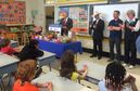 A grade 5 class at Oaklands Elementary School in Victoria participates in an event marking British Columbia's decade-long healthy eating program that brings B.C. fruits, vegetables and milk into classrooms, Monday, May 25, 2015. B.C. Education Minister Peter Fassbender (left to right), Agriculture Minister Norm Letnick, then- Health Minister Terry Lake and Lindsay Babineau, executive director of BC agriculture in classroom, talk to the class. THE CANADIAN PRESS/Dirk Meissner