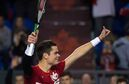 Canada's Milos Raonic, of Toronto, Ont., celebrates after defeating Japan's Tatsuma Ito in straight sets during a Davis Cup tennis world group first round singles match in Vancouver, B.C., on Friday March 6, 2015. THE CANADIAN PRESS/Darryl Dyck