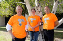 Crocus Plains Regional Secondary School graphic design teacher Brent Lowrie (left), music teacher Deanna Ginn and principal Chad Cobbe show off their orange shirts for Orange Shirt Day. Lowrie designed the logo for the shirts and staff printed them in the school.