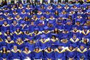 Brandon University graduates wait to receive their degrees during the afternoon convocation at the Healthy Living Centre on Friday. More than 500 BU students graduated on Friday.
