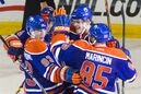 Edmonton Oilers forward Ryan Nugent-Hopkins (93) celebrates his game winning goal against the Tampa Bay Lightning with teammates, from left, Taylor Hall (obscured), Jordan Eberle (14), Mark Fayne (5), and Martin Marincin (85) during third period NHL hockey action in Edmonton, Alta., on Monday October 20, 2014. The Oilers won 3-2. THE CANADIAN PRESS/Amber Bracken