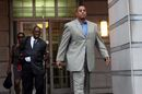 FILE - In this Sept. 23, 2011, file photo, Tate George, former NBA basketball player and the CEO of purported real estate development firm The George Group, leaves federal court in Newark, N.J. George has been jailed since his conviction last fall on four mail fraud counts. His motion to be released on bail was denied by U.S. District Judge Mary Cooper on Wednesday, Oct. 29, 2014. (AP Photo/The Record of Bergen County, Leslie Barbaro, File)