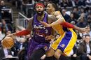 Toronto Raptors forward James Johnson (3) drives past Los Angeles Lakers' Wesley Johnson, right, during first half NBA basketball action in Toronto on Friday, March 27, 2015. THE CANADIAN PRESS/Nathan Denette