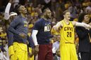 Cleveland Cavaliers guard J.R. Smith, left, forward LeBron James, center, and center Timofey Mozgov (20) react on the sidelines late in the second half of Game 4 of the NBA basketball Eastern Conference Finals against the Atlanta Hawks, Tuesday, May 26, 2015, in Cleveland. The Cavaliers won 118-88. (AP Photo/Tony Dejak)