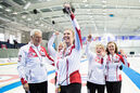 Maureen Bonar, Lois Fowler, Cathy Gauthier and Allyson Stewart celebrate after winning the World Senior Curling Championships in Sochi, Russia.