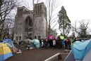FILE - People at the homeless camp are vowing to stay despite the B.C. government's offer of alternate shelter as people speak to media about their concerns in Victoria in a January 11, 2015, file photo. THE CANADIAN PRESS/Chad Hipolito, File