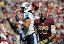 Tennessee Titans quarterback Charlie Whitehurst (12) passes the ball under pressure from Washington Redskins defensive end Jason Hatcher (97), who lost his helmet, during the first half of an NFL football game, Sunday, Oct. 19, 2014, in Landover, Md. (AP Photo/Mark E. Tenally)