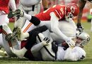 Oakland Raiders quarterback Derek Carr, bottom, is tackled by Kansas City Chiefs linebacker Dee Ford (55) during the second half of an NFL football game in Kansas City, Mo., Sunday, Dec. 14, 2014. (AP Photo/Ed Zurga)