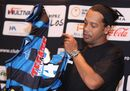Brazil's Ronaldinho puts on his new Queretaro soccer club jersey at a press conference in Mexico City, Friday, Sept. 12, 2014. Mexican first-division club Queretaro signed the former 34-year-old soccer star, who had been without a club since leaving Brazil's Atletico Mineiro in July and had been negotiating with several clubs. The two-time FIFA world player of the year helped Atletico Mineiro win last year's Copa Libertadores for the first time. (AP Photo/Marco Ugarte)